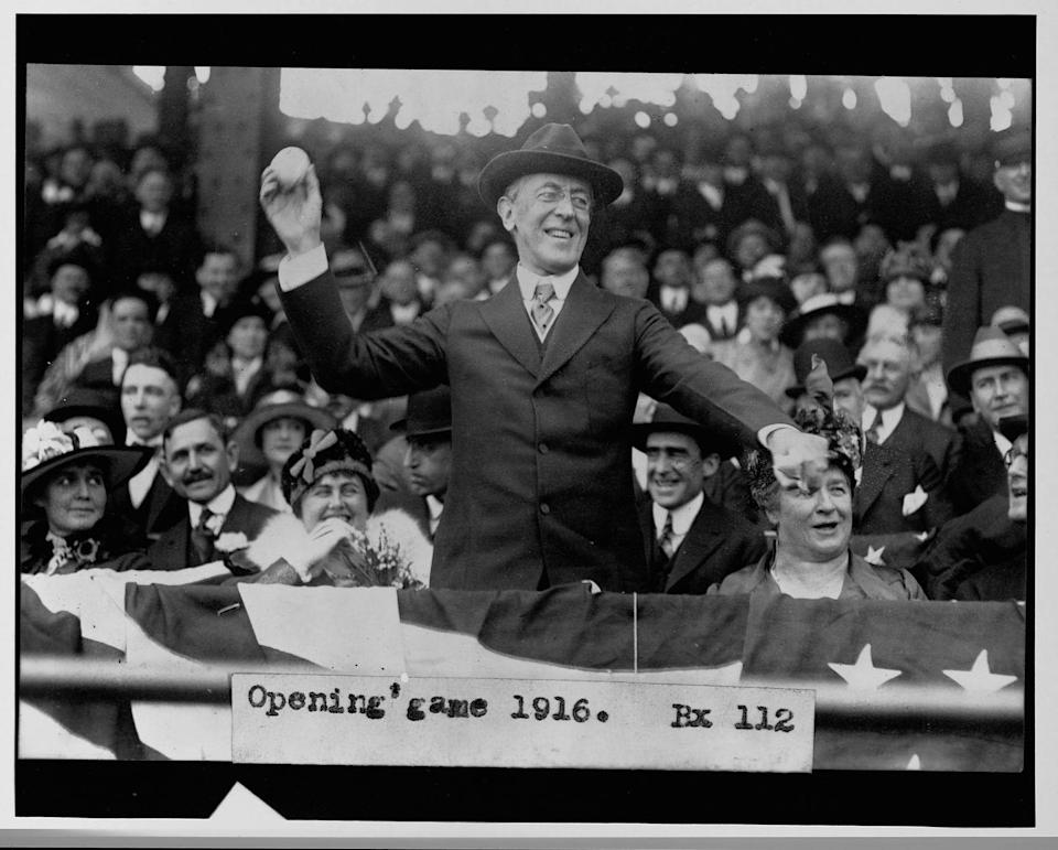 <p>Woodrow Wilson throws out the first pitch at a baseball game in 1916. </p>