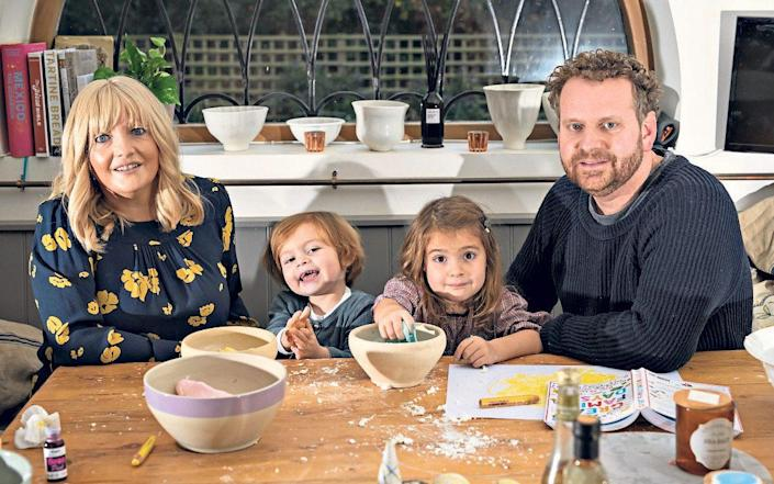 Mandy and Joe Knight with their children Winnie and Otto in Hertfordshire - Christopher Pledger