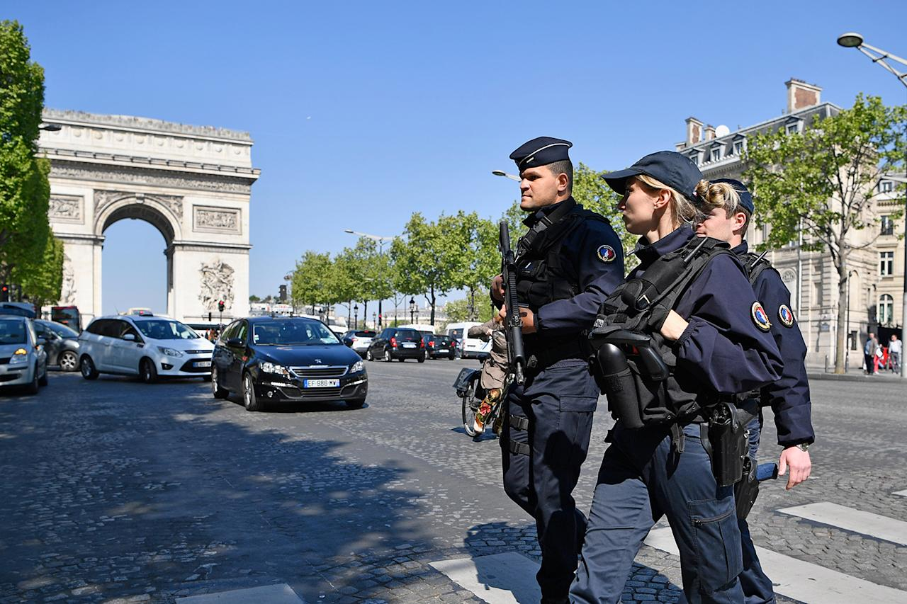 <p>Armed police patrol the Champs Elysees in Paris, Friday, April 21, 2017, following Thursday's shooting of a police officer. One police officer was killed and two others were wounded in a shooting on Paris's Champs Elysees, just days ahead of France's presidential election. (Photo: Jeff J. Mitchell/Getty Images) </p>