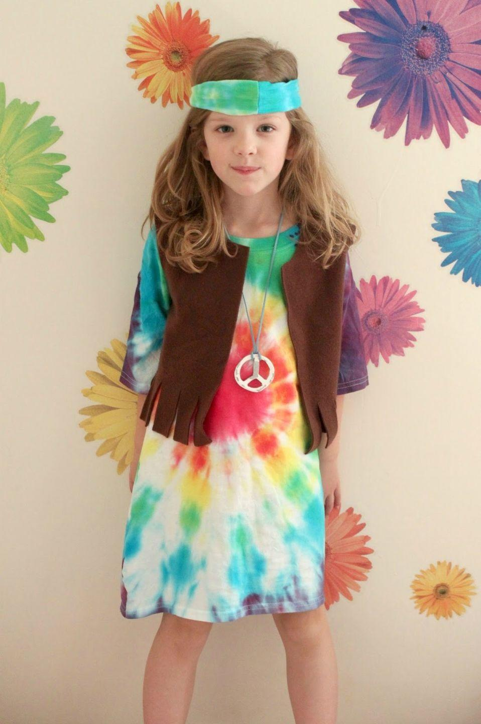"<p>This adorable dress was made using an extra large T-shirt and a tie-dye kit. The vest is made from brown fleece material, but you could just as easily find a ready-made option at a thrift store. </p><p><strong>Get the tutorial at <a href=""http://www.eatsleepmake.com/2014/10/kids-hippie-costume-tutorial.html?crlt.pid=camp.rSAnQQ2dKlD0"" rel=""nofollow noopener"" target=""_blank"" data-ylk=""slk:Eat Sleep Make."" class=""link rapid-noclick-resp"">Eat Sleep Make.</a> </strong></p><p><strong><a class=""link rapid-noclick-resp"" href=""https://www.amazon.com/Amscan-840572-Peace-Sign-Necklace/dp/B00J0I14YO/ref=sr_1_3?tag=syn-yahoo-20&ascsubtag=%5Bartid%7C10050.g.28305469%5Bsrc%7Cyahoo-us"" rel=""nofollow noopener"" target=""_blank"" data-ylk=""slk:SHOP PEACE SIGN NECKLACES"">SHOP PEACE SIGN NECKLACES</a></strong></p>"