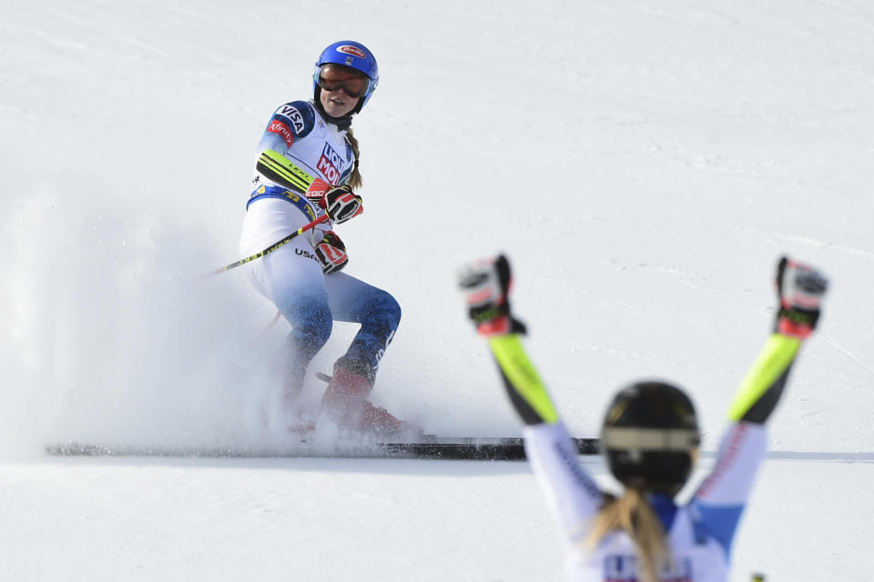 Switzerland's Lara Gut-Behrami celebrates winning the gold medal as United States' Mikaela Shiffrin comes in second in a women's giant slalom, at the alpine ski World Championships, in Cortina d'Ampezzo, Italy, Thursday, Feb. 18, 2021. (AP Photo/Marco Tacca)