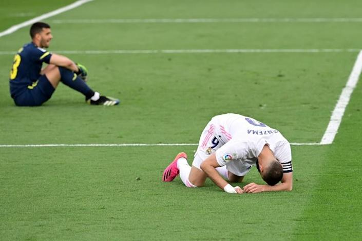 Shattered: Real Madrid's Karim Benzema is stunned after Atletico win title