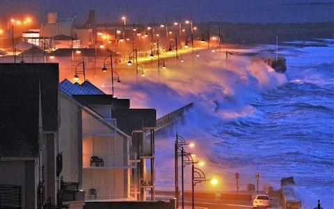 Storm Brendan sends waves crashing over the sea wall in Tramore in County Waterford, on the southeast coast of Ireland, on Monday  - Credit: Brendan St John/Mercury Press
