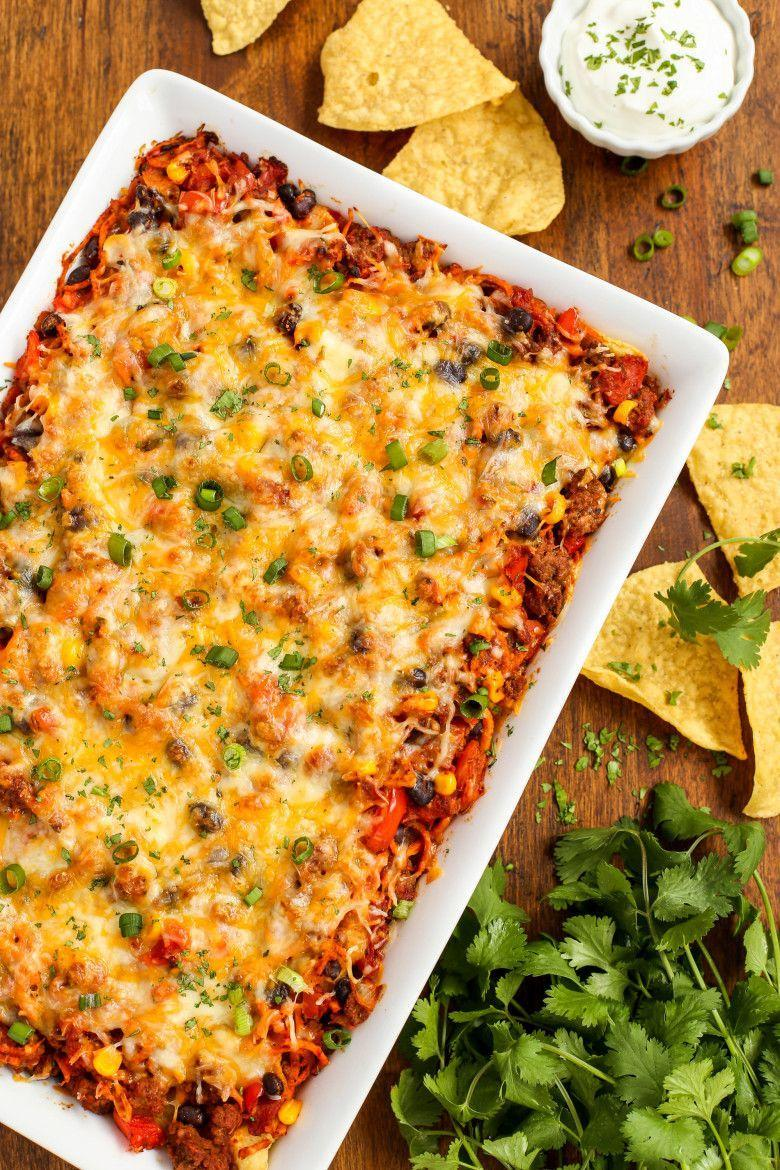 """<p>The only thing you'll need to eat this taco casserole is a big appetite. Tortilla chips are baked right into the layers!</p><p><strong><a href=""""https://thepioneerwoman.com/food-and-friends/cheesy-beef-and-sweet-potato-taco-casserole/"""" rel=""""nofollow noopener"""" target=""""_blank"""" data-ylk=""""slk:Get the recipe."""" class=""""link rapid-noclick-resp"""">Get the recipe.</a></strong></p><p><a class=""""link rapid-noclick-resp"""" href=""""https://go.redirectingat.com?id=74968X1596630&url=https%3A%2F%2Fwww.walmart.com%2Fsearch%2F%3Fquery%3Dfood%2Bprep%2Btools&sref=https%3A%2F%2Fwww.thepioneerwoman.com%2Ffood-cooking%2Fmeals-menus%2Fg31929060%2Feasy-casserole-recipes%2F"""" rel=""""nofollow noopener"""" target=""""_blank"""" data-ylk=""""slk:SHOP FOOD PREP"""">SHOP FOOD PREP</a> </p>"""