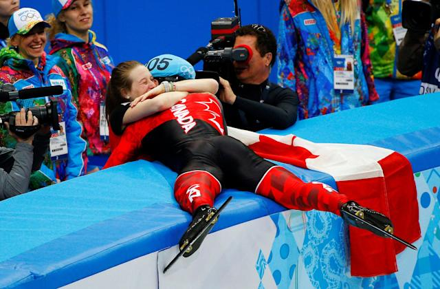 FILE PHOTO: Winner Canada's Charles Hamelin hugs his girlfriend and compatriot speed skater Marianne St-Gelais after the men's 1,500 metres short track speed skating race finals at the Iceberg Skating Palace during the 2014 Sochi Winter Olympics February 10, 2014. Ê REUTERS/Brian Snyder/File Photo