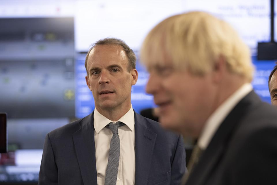 Prime Minister Boris Johnson and Foreign Secretary Dominic Raab visiting the Foreign, Commonwealth and Development Office Crisis Centre in Whitehall, London, to see how they are supporting and monitoring the ongoing evacuations in Afghanistan. Picture date: Friday August 27, 2021.