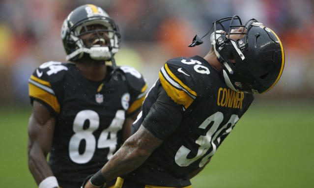 Pittsburgh Steelers running back James Conner (30) celebrates with wide receiver Antonio Brown (84) after Conner scored a 22-yard touchdown during the second half of an NFL football game against the Cleveland Browns, Sunday, Sept. 9, 2018, in Cleveland. (AP Photo/Ron Schwane)
