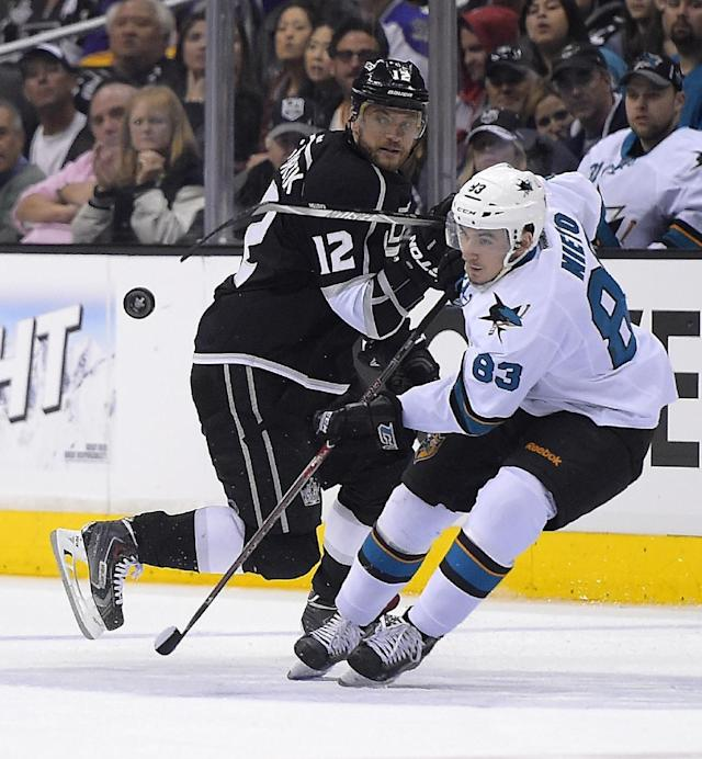 Los Angeles Kings right wing Marian Gaborik, left, of Slovakia, and San Jose Sharks left wing Matt Nieto watch the puck during the second period in Game 6 of an NHL hockey first-round playoff series, Monday, April 28, 2014, in Los Angeles. (AP Photo)