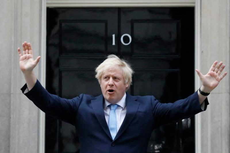 "Britain's Prime Minister Boris Johnson participates in a national ""clap for carers"" to show thanks for the work of Britain's NHS (National Health Service) workers and other frontline medical staff around the country as they battle with the novel coronavirus pandemic, outside 10 Downing Street in London on May 21, 2020. - The British government on on May 21 announced that foreign care workers would be exempt from a charge imposed on migrants to fund the health service, after an outcry sparked by the coronavirus outbreak. (Photo by Tolga AKMEN / AFP) (Photo by TOLGA AKMEN/AFP via Getty Images)"