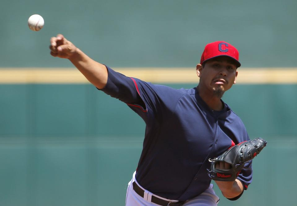 Cleveland Indians' Carlos Carrasco throws a pitch against the Milwaukee Brewers during the first inning of a spring training baseball game Friday, April 3, 2015, in Goodyear, Ariz. (AP Photo/Ross D. Franklin)