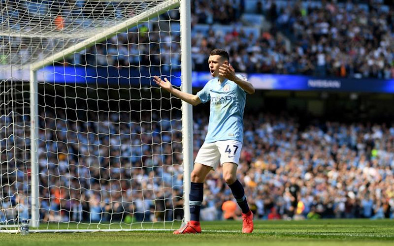 Phil Foden of Manchester City celebrates after scoring his team's first goal during the Premier League match between Manchester City and Tottenham Hotspur - Getty Images Europe