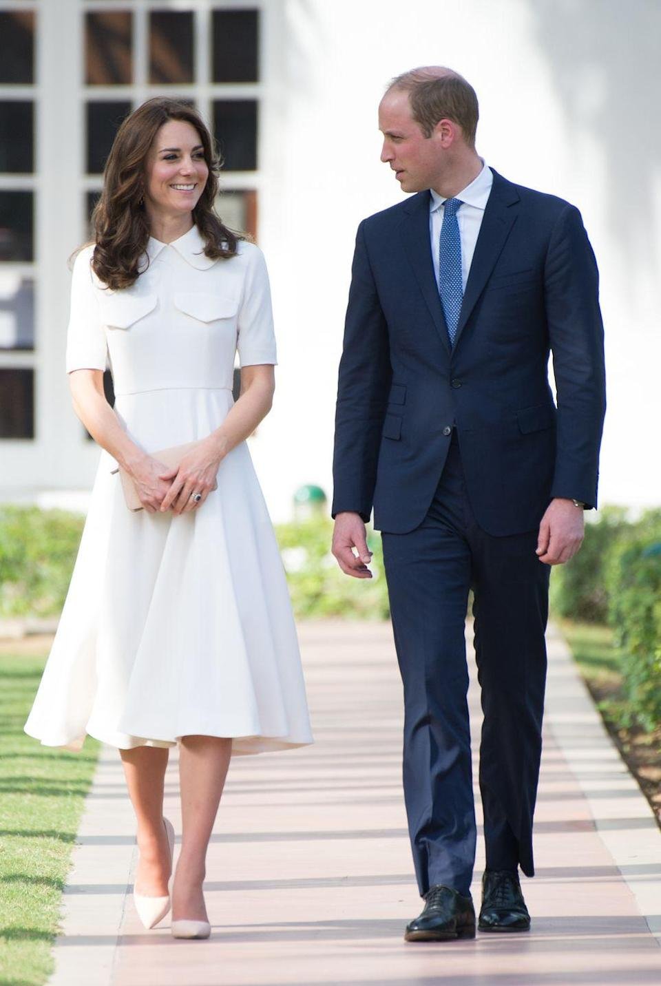 "<p>Kate wears a white button up A-line dress by <a href=""http://www.emiliawickstead.com/"" rel=""nofollow noopener"" target=""_blank"" data-ylk=""slk:Emilia Wickstead"" class=""link rapid-noclick-resp"">Emilia Wickstead</a> during a visit to the Mahatma Gandhi museum in New Delhi. </p>"