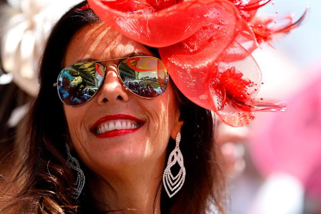 Horse Racing - Royal Ascot - Ascot Racecourse, Ascot, Britain - June 21, 2018 A racegoer in the stands before the start of the racing REUTERS/Peter Nicholls