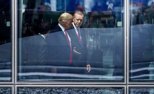PHOTO: President Donald Trump and Turkey's President Recep Tayyip Erdogan talk during the NATO (North Atlantic Treaty Organization) summit in Brussels, July 11, 2018. (Brendan Smialowski/AFP via Getty Images, FILE)