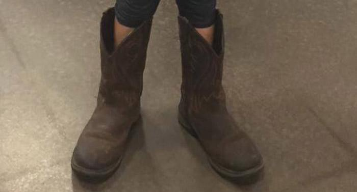 A young girl wore her late father's boots on his birthday. (Photo: Facebook)