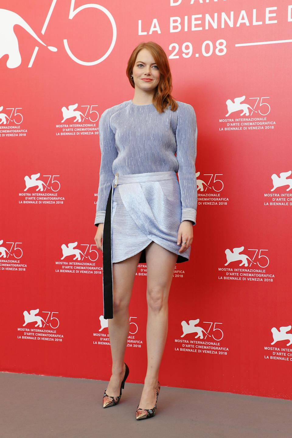 <p>The actress paired a silver Louis Vutton top with a wrap mini skirt by the same label. <em>[Photo: Getty]</em> </p>