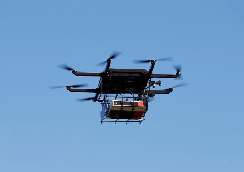 FILE PHOTO: A drone demonstrates delivery capabilities from the top of a UPS truck during testing in Lithia, Florida