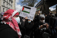 Protesters gather during a banned protest in support of Palestinians in the Gaza Strip, Saturday, May, 15, 2021 in Paris. Marches in support of Palestinians in the Gaza Strip were being held Saturday in a dozen French cities, but the focus was on Paris, where riot police got ready as organizers said they would defy a ban on the protest. (AP Photo/Michel Euler)