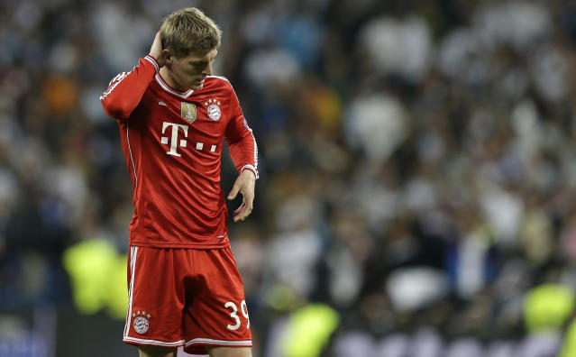 Bayern's Toni Kroos touches his head after a Champions League semifinal first leg soccer match between Real Madrid and Bayern Munich at the Santiago Bernabeu stadium in Madrid, Spain, Wednesday, April 23, 2014. (AP Photo/Paul White)