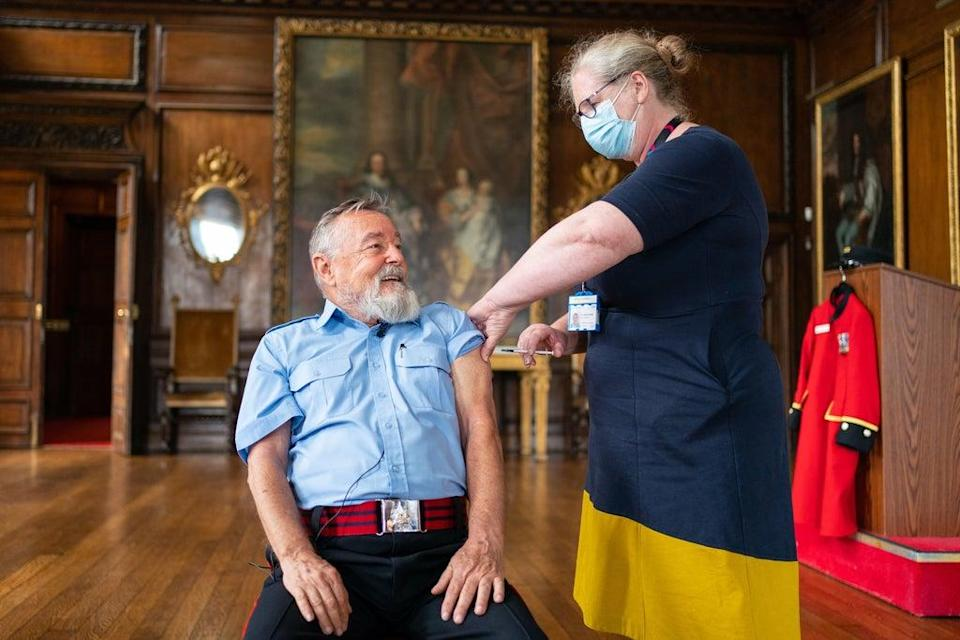 Chelsea Pensioner John Byrne receives a Covid-19 booster vaccination from deputy chief nurse Vanessa Sloane at the Royal Hospital Chelsea in London (Dominic Lipinski/PA) (PA Wire)