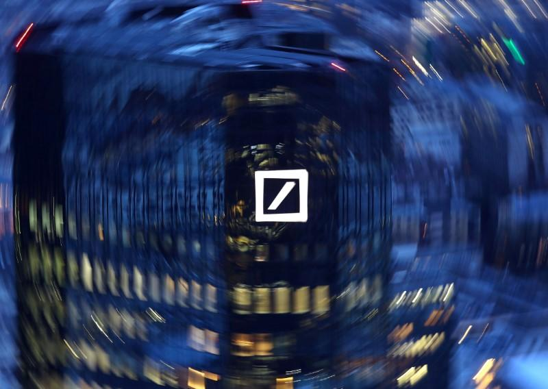 FILE PHOTO: The head quarters of Germany's Deutsche Bank are photographed early evening in Frankfurt