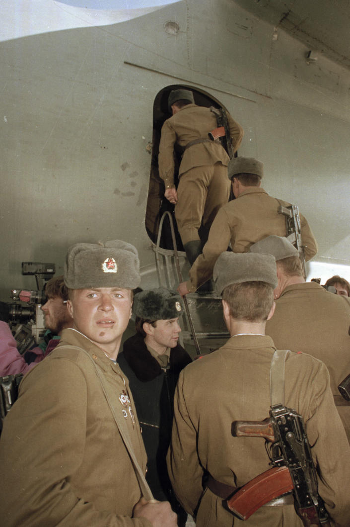 FILE -in this Feb. 13, 1989 file photo, the last Soviet unit climbs aboard a Soviet military transport plane in Kabul, Afghanistan, as Soviet troops complete their withdrawal after a decade of military occupation. Afghanistan is marking the 31st anniversary of the Soviet Union's last soldier leaving the country, Saturday, Feb. 15, 2020. This year's anniversary comes as the United States negotiates its own exit after 18 years of war, America's longest. (AP Photo/Laurent Rebours)