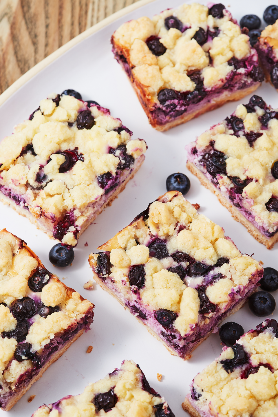 """<p>This will always be one of our favorite flavor combos.</p><p>Get the recipe from <a href=""""https://www.delish.com/cooking/recipe-ideas/a27020536/blueberry-lemon-pie-bars-recipe/"""" rel=""""nofollow noopener"""" target=""""_blank"""" data-ylk=""""slk:Delish"""" class=""""link rapid-noclick-resp"""">Delish</a>.</p>"""