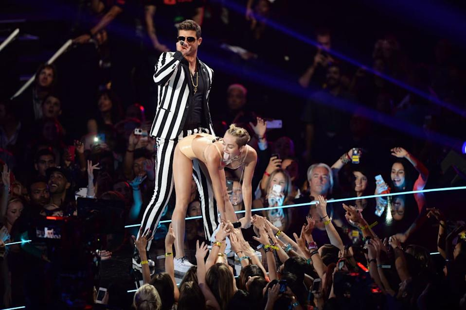 "<div class=""inline-image__caption""><p> Robin Thicke and Miley Cyrus perform onstage during the 2013 MTV Video Music Awards at the Barclays Center on August 25, 2013 in the Brooklyn borough of New York City. </p></div> <div class=""inline-image__credit"">Andrew H. Walker/Getty</div>"