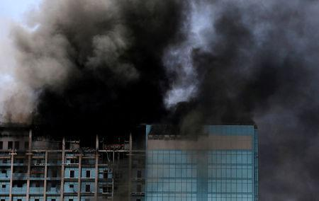 Smoke rises after a fire broke out in a building in Abu Dhabi, UAE, August 30, 2016. REUTERS/Stringer