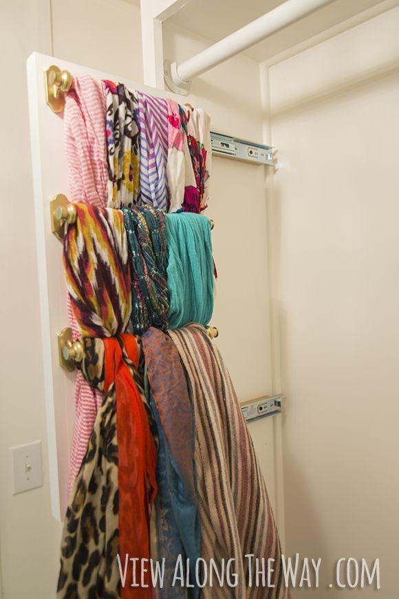 """<p>If this list teaches you anything, it's that there can never be too many scarf organizing ideas. This DIY pull-out shelf is for those who are serious about their neckwear (and also saving space in one's closet).</p><p><a href=""""http://www.viewalongtheway.com/2014/03/girly-glam-closet-makeover-reveal/"""" rel=""""nofollow noopener"""" target=""""_blank"""" data-ylk=""""slk:Get the tutorial at View Along The Way »"""" class=""""link rapid-noclick-resp""""><em>Get the tutorial at View Along The Way »</em></a></p>"""