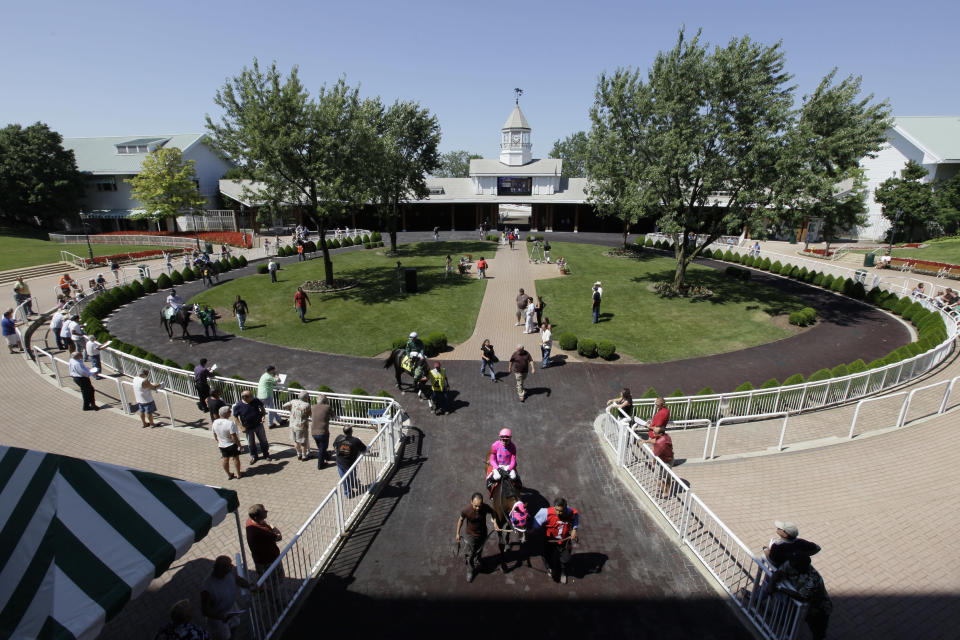 FILE - In this July 16, 2010, file photo, orses and jockeys make their way from the paddock to the race track at Arlington Park in Arlington Heights, Ill. The racetrack is expected to close after the completion of racing on Sept. 25, with ownership taking bids for the future of the land. (AP Photo/M. Spencer Green)