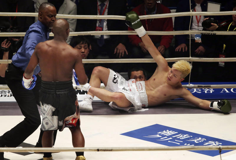 Japanese kickboxer Tenshin Nasukawa lies on the mat after being knocked out by Floyd Mayweather Jr. during first round of their three-round exhibition match on New Year's Eve at Saitama Super Arena in Saitama north of Tokyo Monday Dec. 31 2018