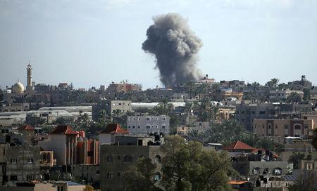 Smoke rises following an Israeli air strike in northern Gaza Strip