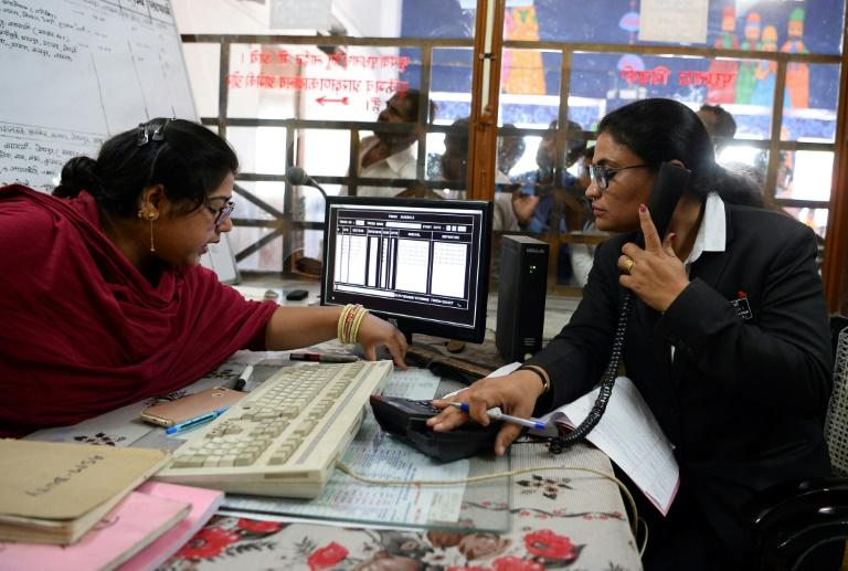 Mahima Dutt Sharma rolls her eyes when men make excuses to gawk at her inside the booth where she checks tickets at India's only interstate train station run entirely by women