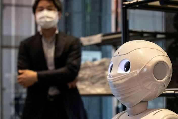 Pepper is also there to remind patients to eat healthily and not bring alcohol into quarantine (AFP Photo/Philip FONG)