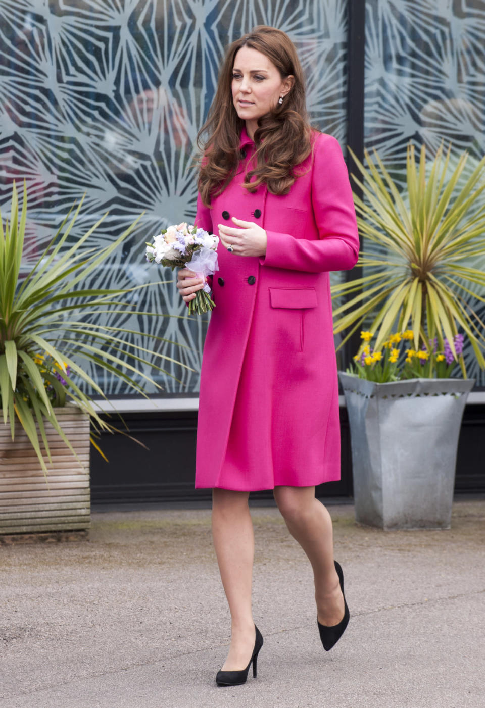 <p>A hot pink Mulberry coat was Kate's outfit of choice for a day in South London. Accessories included suede Stuart Weitzman pumps and her treasured Mulberry Bayswater clutch.</p><p><i>[Photo: PA]</i></p>