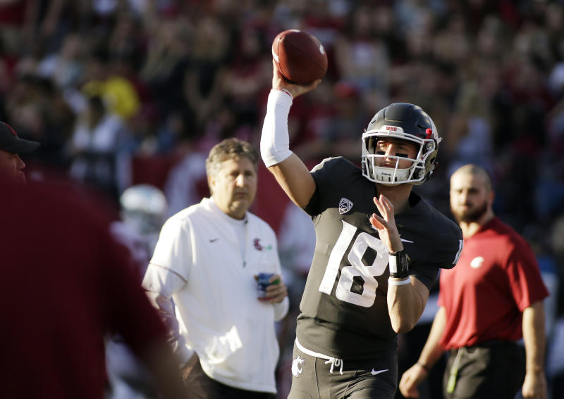 FILE - In this Saturday, Oct. 20, 2018, file photo, Washington State quarterback Anthony Gordon (18) throws a pass while warming up before an NCAA college football game against Oregon in Pullman, Wash. Washington State has a spirited quarterback competition involving a large group of would-be starters, including seniors Gordon and Trey Tinsley, Cammon Cooper, graduate transfer Gage Gubrud and sophomore John Bledsoe. (AP Photo/Young Kwak, File)