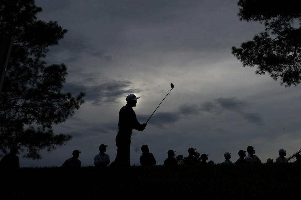 Dustin Johnson watches his tee shot on the 18th tee during the second round of the Masters golf tournament on Friday, April 9, 2021, in Augusta, Ga. (AP Photo/Charlie Riedel)