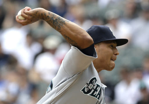 Seattle Mariners starter Taijuan Walker throws against the Chicago White Sox during the first inning of a baseball game in Chicago, Sunday, July 6, 2014. (AP Photo/Nam Y. Huh)