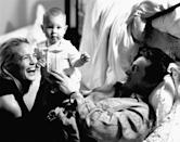 <p>Sean Penn relaxes in his Malibu home with girlfriend, Robin Wright, and their newborn daughter, Dylan, in 1991. </p>