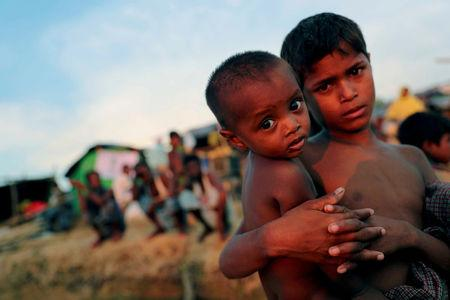 FILE PHOTO: Rohingya refugee children look on at a refugee camp in Palang Khali near Cox's Bazar, Bangladesh, October 4, 2017. REUTERS/Mohammad Ponir Hossain/File Photo