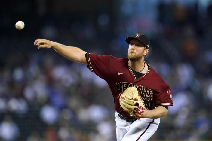 Arizona Diamondbacks starting pitcher Merrill Kelly throws to a Chicago Cubs batter during the first inning of a baseball game Sunday, July 18, 2021, in Phoenix. (AP Photo/Ross D. Franklin)