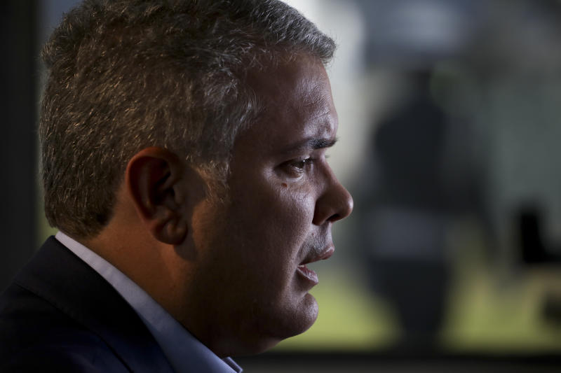 Colombia's President Ivan Duque speaks during an interview with The Associated Press at the CATAM air base in Bogota, Colombia, Saturday, Sept. 21, 2019. Duque's will speak before the United Nations General Assembly and is expected to condemn Venezuelan leader Nicolás Maduro as an abusive autocrat who is not only responsible for the country's humanitarian catastrophe but is also now a threat to regional stability for his alleged harboring of Colombian rebels labeled a terrorist group by the U.S. and European Union. (AP Photo/Ivan Valencia)
