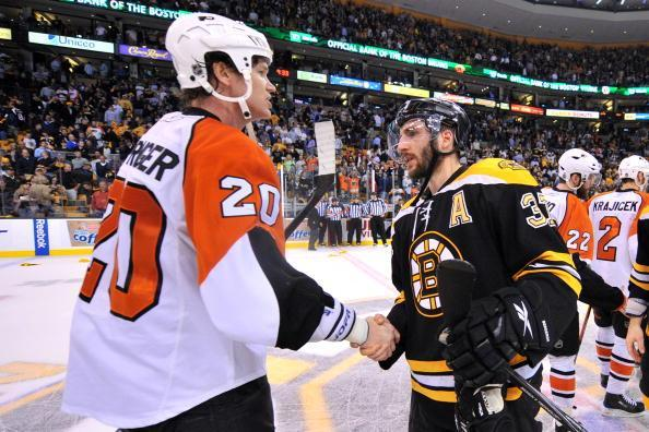 BOSTON – MAY 14: Patrice Bergeron #37 of the Boston Bruins shakes hands with Chris Pronger #20 of the Philadelphia Flyers after Game Seven of the Eastern Conference Semifinals during the 2010 NHL Stanley Cup Playoffs at the TD Garden on May 14, 2010 in Boston, Massachusetts. (Photo by Brian Babineau/NHLI via Getty Images)