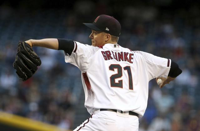 Arizona Diamondbacks starting pitcher Zack Greinke throws against the Los Angeles Dodgers during the first inning of a baseball game Monday, June 24, 2019, in Phoenix. (AP Photo/Ross D. Franklin)