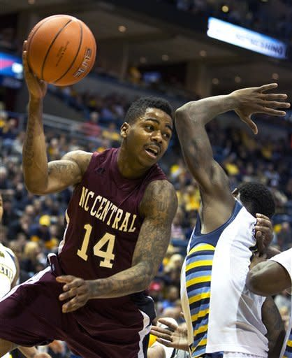 Marquette's' Jamil Wilson, right, blocks the path of North Carolina Central's Jeremy Ingram forcing him to pass the ball during the second half of an NCAA college basketball game, Saturday, Dec. 29, 2012, in Milwaukee. (AP Photo/Tom Lynn)