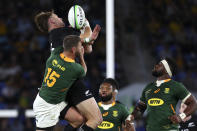 New Zealand's Jordie Barrett, left, competes for a high ball with South Africa's Willie le Roux for during their Rugby Championship test match on the Gold Coast, Australia, Saturday, Oct. 2, 2021. (AP Photo/Tertius Pickard)