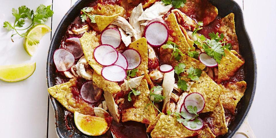 "<p>Tortilla chips aren't just for snacking! Layer this party staple with homemade salsa, shredded chicken, cilantro, sour cream and limes to turn it into a satisfying supper.</p><p><em><a href=""https://www.goodhousekeeping.com/food-recipes/easy/a34557/chicken-chilaquiles"" rel=""nofollow noopener"" target=""_blank"" data-ylk=""slk:Get the recipe for Chicken Chilaquiles »"" class=""link rapid-noclick-resp"">Get the recipe for Chicken Chilaquiles »</a></em></p>"