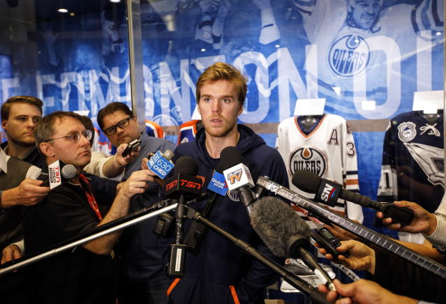 Edmonton Oilers NHL hockey player Connor McDavid speaks to media during the Oilers training camp in Edmonton, Alberta Thursday Sept, 12, 2019. (Jason Franson/The Canadian Press via AP)
