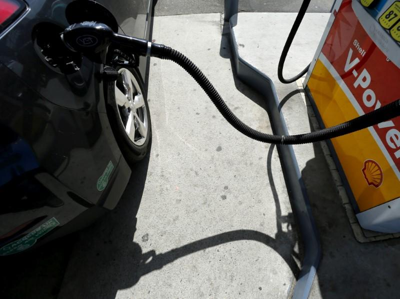 A car is filled with gasoline at a gas station in Carlsbad